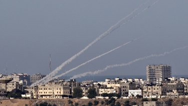 Attacks labelled war crimes: A picture taken from the southern Israeli city of Sderot shows four rockets being launched from the Gaza Strip into Israel on November 16, 2012.