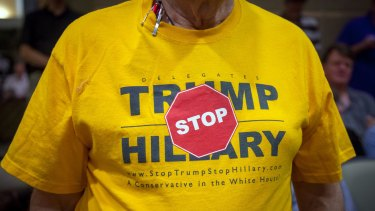 A conservative voter shows off a T-shirt he picked up at the Republican State Convention during a campaign stop by Evan McMullin.