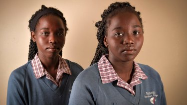 Tahbisa (right) says braiding makes her hair healthier and easier to manage.