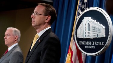Attorney General Jeff Sessions, left, and Deputy Attorney General Rod Rosenstein, right, at a briefing at the Justice Department in Washington on August 4.