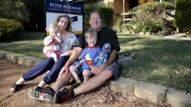 Chris Sims and Charmaine Sims with their son Zac Sims 3 and daughter Alma 20 months are moving on from Mr Fluffy after buying a new home in Kambah.