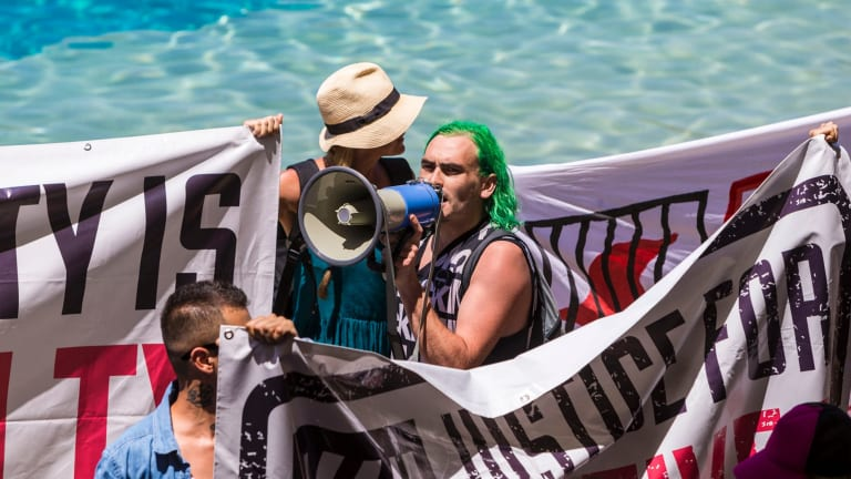 Protesters at Sea World during the dolphin show on Saturday morning.