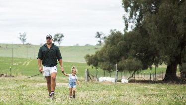 Brumbies hooker Josh Mann-Rea with his daughter Avery at home in Jugiong, NSW.