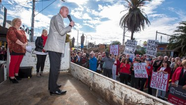 Opposition public transport spokesman David Hodgett speaks at the rally in Essendon.