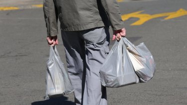 Ban the bag?: A shopper with plastic bags from a Miranda supermarket.
