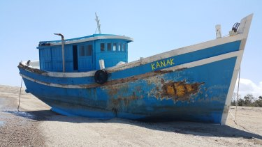 The Kanak, the boat that was stranded on the reefs near Landu Island after Australian officials allegedly paid people smugglers to return to Indonesia.