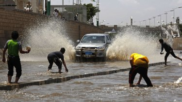 Boys play in floodwaters after heavy rain in Sanaa last week.