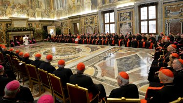 Pope Francis delivers his message during his meeting with Cardinals and Bishops of the Vatican Curia.