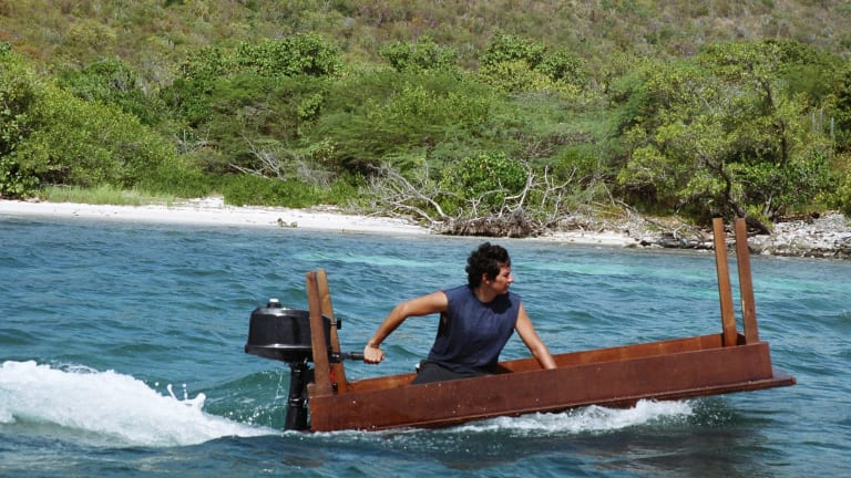In Allora & Calzadilla's Under Discussion, 2005, an upturned table with an outboard motor goes on a journey off Puerto Rico.