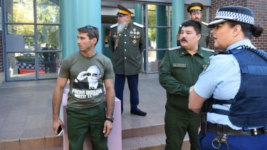 Retired Russian soldiers at Burwood court, where a man charged with damaging Russian Orthodox graves faces charges.