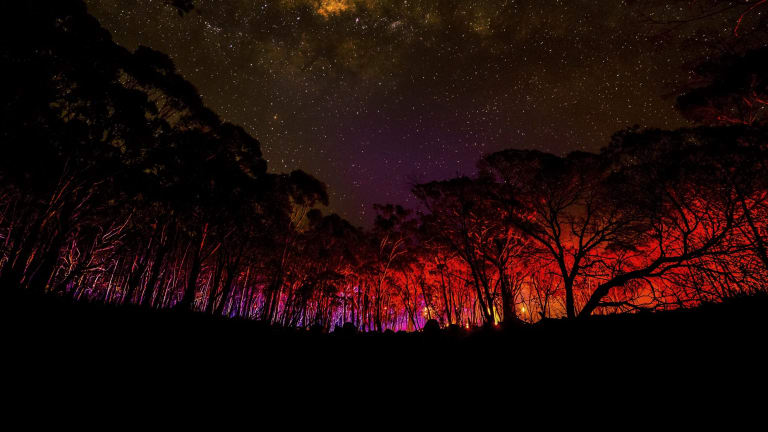 Justin McManus' photo of lights from CFA trucks during the Lancefield fires, on display at the Sydney Town Hall during the Head On Photo Festival.