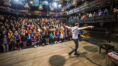 Musical director Luke Byrne leads a 'super rehearsal' for The Events with 300 singers from 10 different choirs at the Malthouse Theatre.