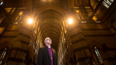 Anglican Archbishop Dr Philip Freier in St Paul's Cathedral after the church's 350 lights were replaced with energy-efficient bulbs to cut emissions and save power.