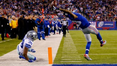 What a catch: New York Giants wide receiver Odell Beckham scores a touchdown against Brandon Carr of the Dallas Cowboys at MetLife Stadium on November 23, 2014.