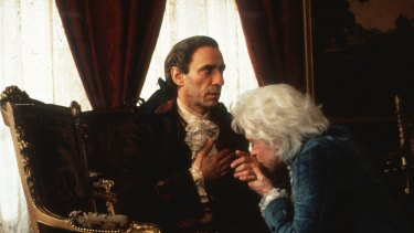 "F. Murray Abraham as ""old"" Antonio Salieri and Tom Hulce as Wolfgang Amadeus Mozart in Amadeus."