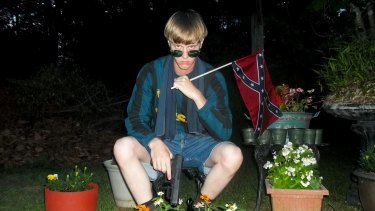 Dylann Roof posing for a photo while holding a Confederate flag: an undated image that appeared on Lastrhodesian.com, a website investigated by the FBI in connection with Charleston shootings.