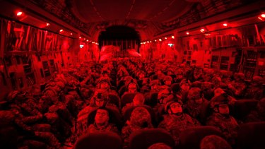 US soldiers on a military transport from Kyrgyzstan to Afghanistan in 2010.