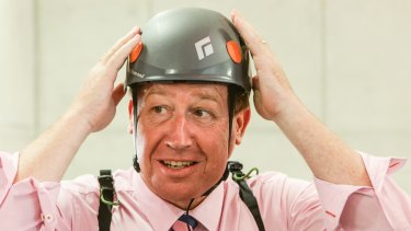 Safety first: Deputy Premier and Arts Minister Troy Grant prepares to ride the flying fox at Barangaroo.