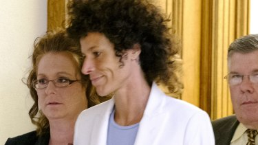 Andrea Constand, who accused Bill Cosby of sexual assault, leaves the courtroom after a mistrial was declared.