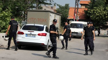 Turkish police raid the homes of IS suspects in Ankara on Monday.