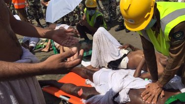 A pilgrim is treated by a medic after the September 24 stampede in Mina, now believed to have claimed the lives of more than 2400 people.