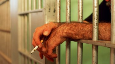 Prisoners who smoke are being forced to quit, while resident officers will have designated smoking areas.