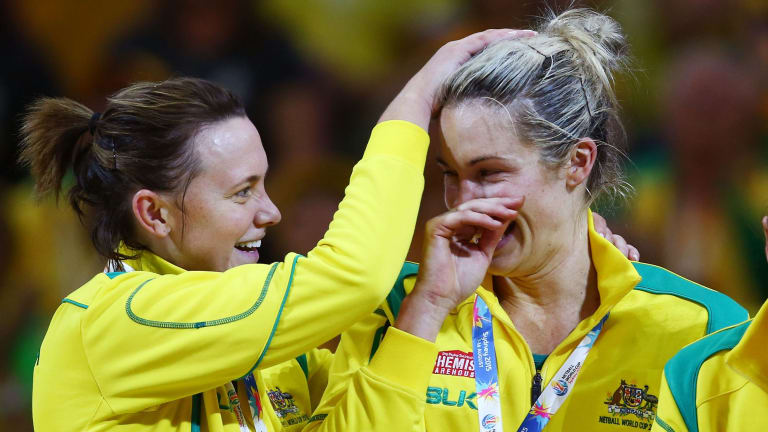 Julie Corletto (right) of the Diamonds celebrates with Natalie Medhurst (left) after the final.
