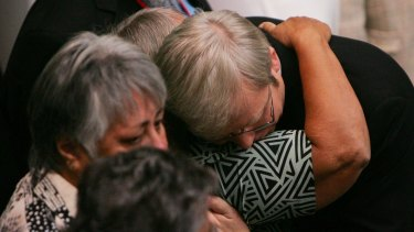 Kevin Rudd hugs guests after his apology to Indigenous Australians.