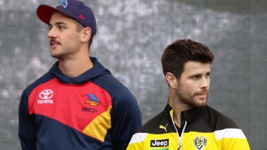 Walker and hunter: Taylor Walker and Trent Cotchin on Friday.
