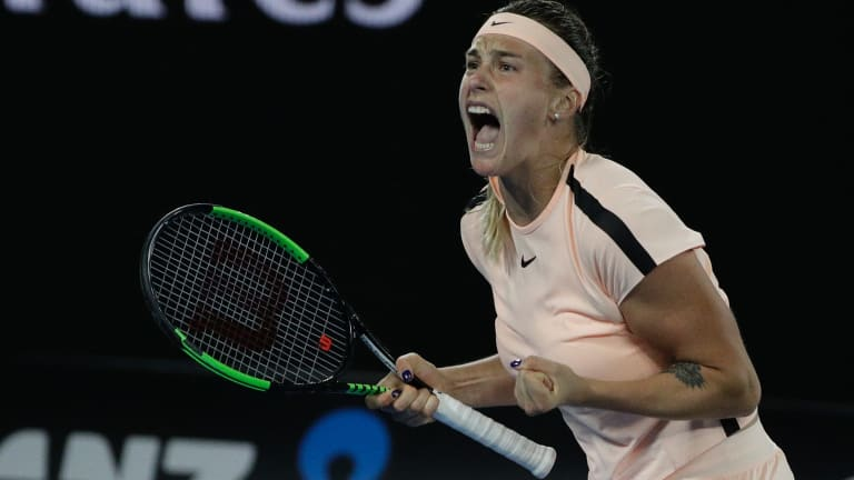 Aryna Sabalenka of Belarus reacts during her first-round match against Australia's Ashleigh Barty at the Australian Open.