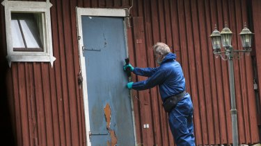 A police forensic officer works at a property outside Knislinge in southern Sweden where the 38-year-old woman was allegedly taken.