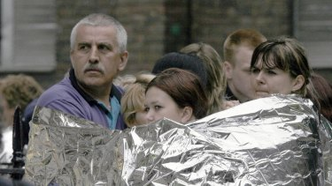 Londoners wrapped in emergency blankets after the explosion in Tavistock Square, in London.