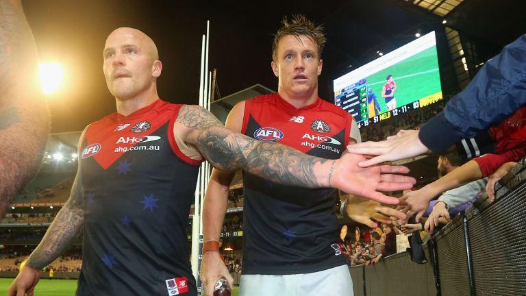 Nathan Jones (left) will lead the Demons again.