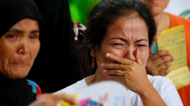 Displaced residents of Marawi city cry upon receiving assurance of support from local officials at an evacuation centre in Balo-i township, Lanao del Norte province,  on Wednesday.