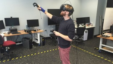 Exploring the virtual breast cancer cell using virtual reality at UNSW's Art and Design school in Paddington.