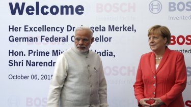 German Chancellor Angela Merkel, right, and Indian Prime Minister Narendra Modi at German engineering company Bosch's vocational centre in Bangalore, India, on Tuesday.