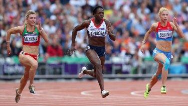 Yuliya Balykina, left, races Anyika Onuora (Britain) and Olga Belkina (Russia) in the 100-metre heats at the London Olympics.