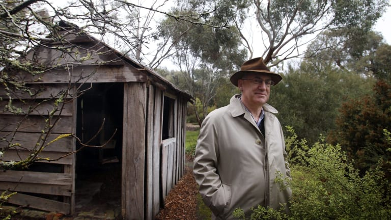 Allan Myers, QC, on his property in Dunkeld beside a hut where his great-grandfather lived.