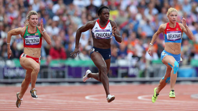 Yuliya Balykina, left, races Anyika Onuora (Britain) and Olga Belkina (Russia) in the 100-metre heats at the London Olympics.