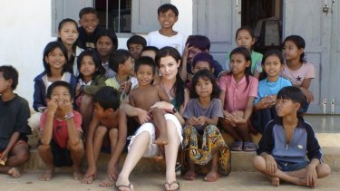 "Tara Winkler (seen here with Cambodian children in 2007) set up her own orphanage in  Battambang, in the west of the country, before turning away from centre-based care for children, which she now calls a ""trap""."