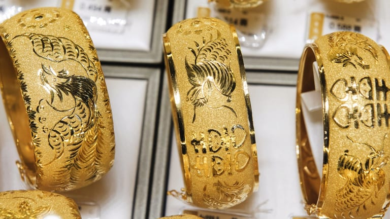 Gold bangles on display in a Hong Kong jewellery shop last month.
