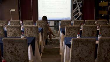 A lone reporter monitors what is supposedly the live court transcript displayed at a press centre near the Tianjin No. 2 Intermediate People's Court On August 2.