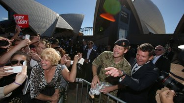 Prince Harry and NSW Premier Mike Baird greet crowds at the Opera House.