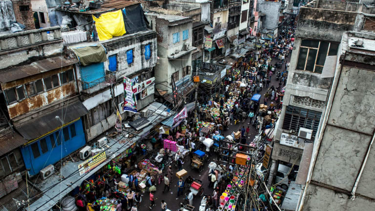 Old Delhi: crumbling city walls, labyrinths of tiny lanes always crowded with rickshaws and people walking in every direction.