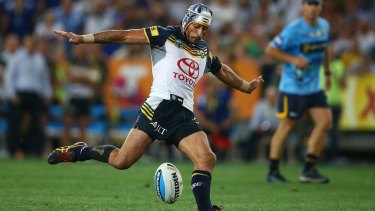 Iconic moment: Johnathan Thurston kicks the Cowboys to their first premiership.