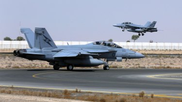 A Royal Australian Air Force F/A-18F Super Hornet takes off for a combat mission over Iraq.