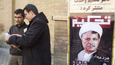 The results suggest that former president Ayatollah Ali Akbar Hashemi Rafsanjani, seen on the right in a magazine cover, may have returned to the centre of power.
