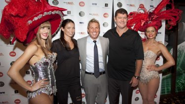 Shane Warne with Erica Baxter and James Packer at one of his charity's poker events at Crown Casino.