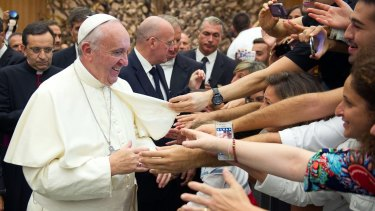 Pope Francis greets the faithful at the Vatican at the weekend.
