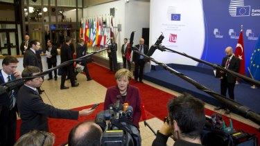 German Chancellor Angela Merkel speaks on arrival at the EU-Turkey summit in Brussels.